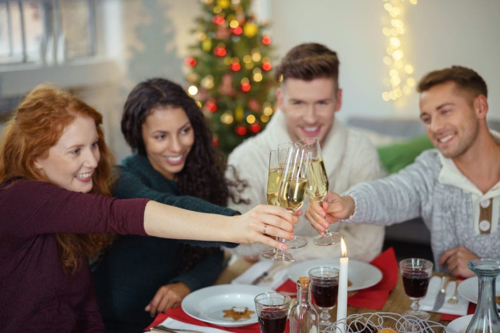 coworkers toasting champagne at office holiday party