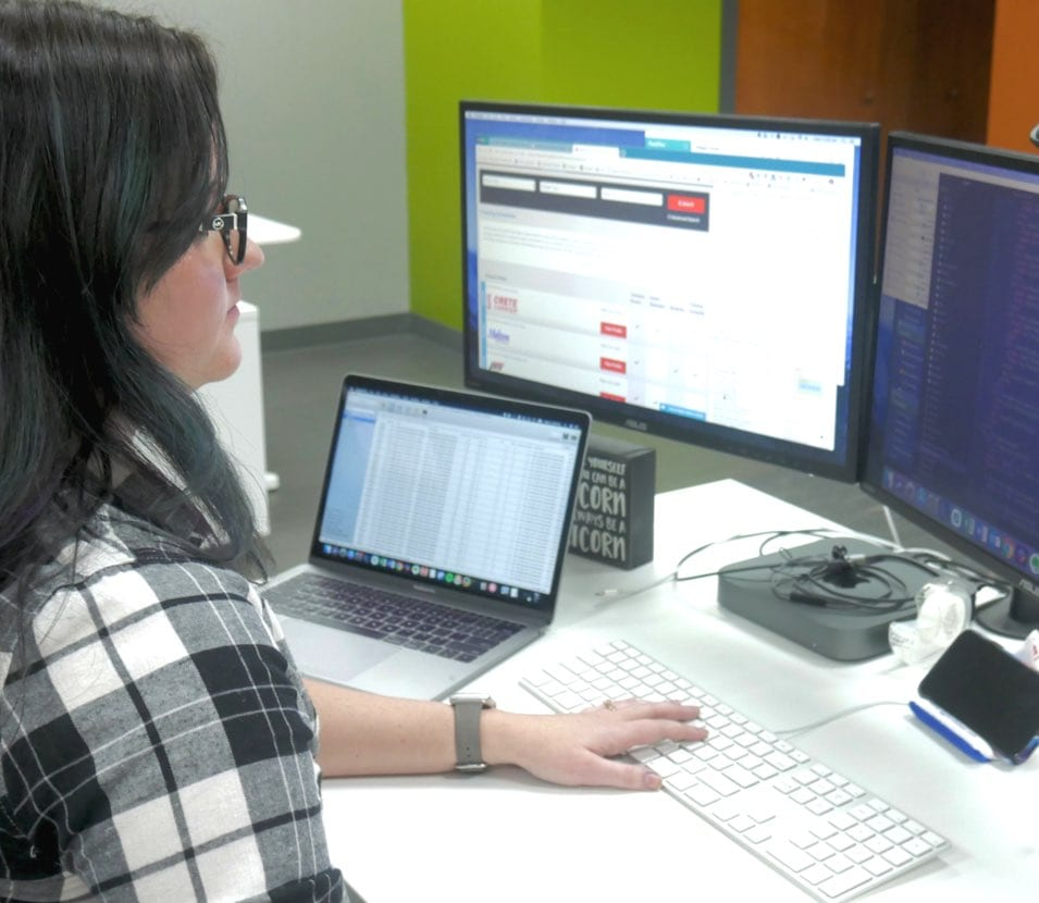 Team member working on TrackFive product improvements